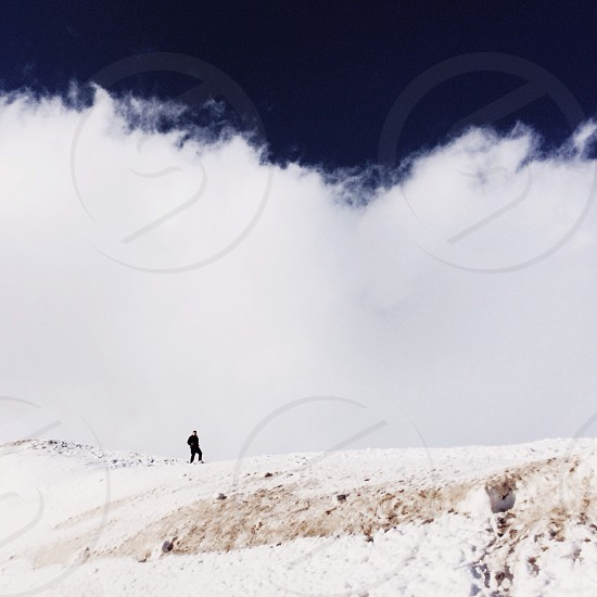 silhouette of person on snow covered field photo