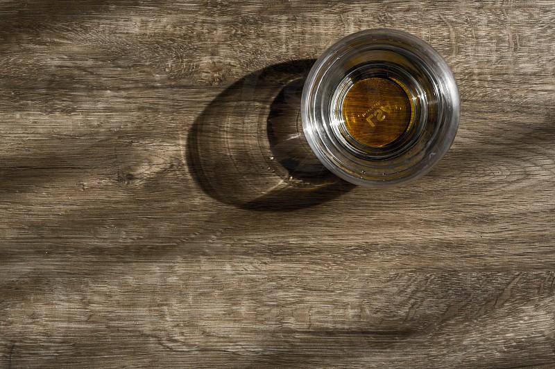 Whiskey glass shadow photo