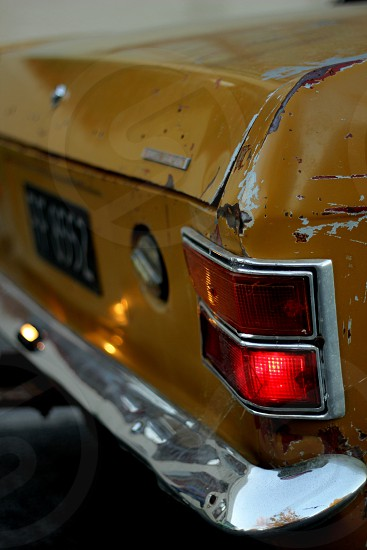 A beaten up Ford Cortina  photo