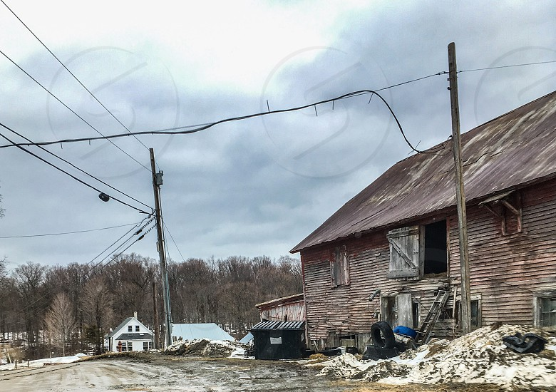 Hard times - Barn falling down red winter rural Vermont wood worn photo