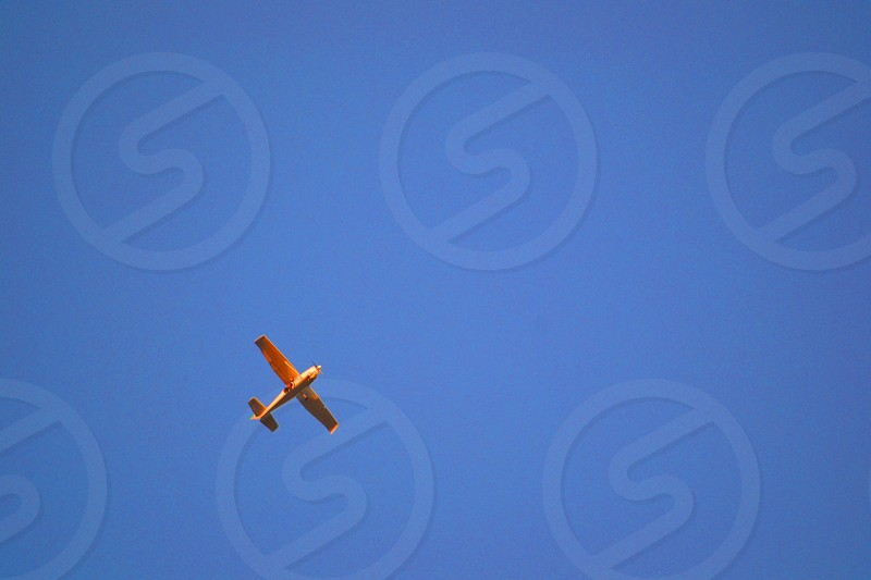 beige biplane on sky photography photo