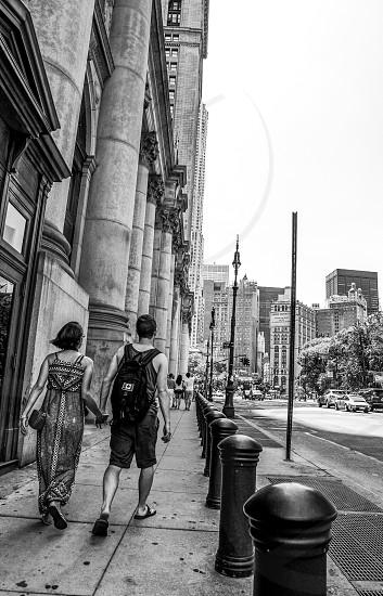 Couple together New York Manhattan hands holding hands walking walk stroll love explore  photo