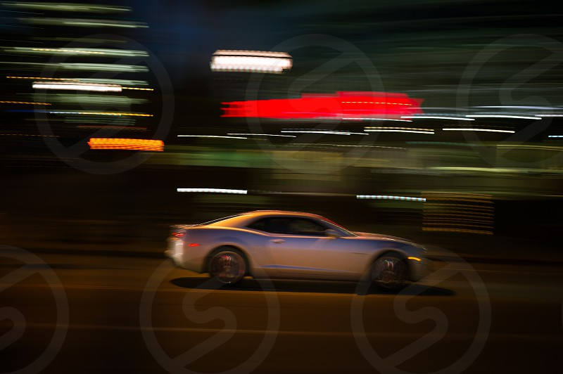 Camaro speeding through the city at night photo