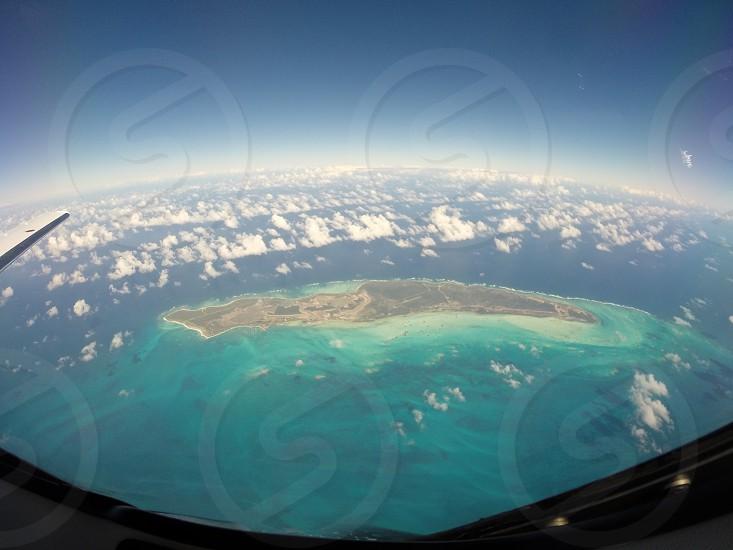 Caribbean ocean island aircraft airplane 35000 feet clouds earth photo
