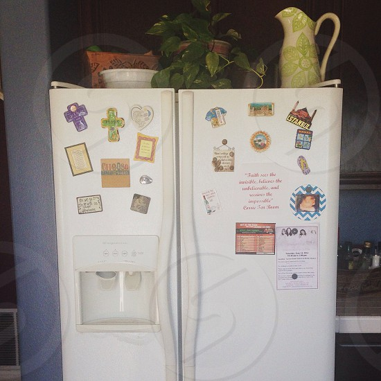white french type refrigerator with water dispenser photo