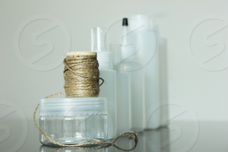 clear round container and gray string spool photo