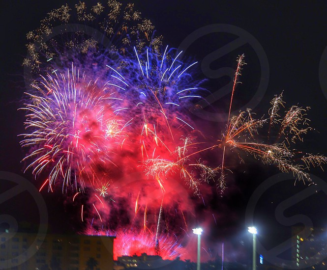 view of blue and red fire works photo