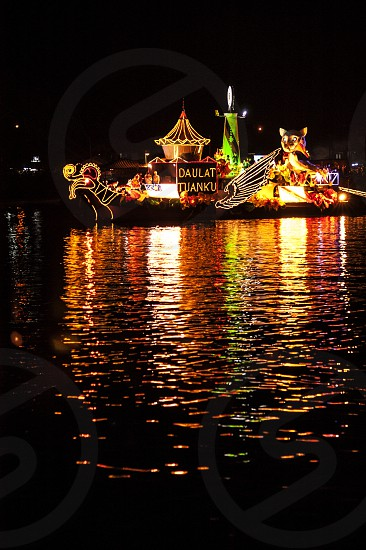 Water reflection of a boat in river float parade. photo