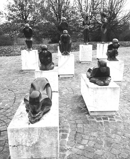 black and white people in yoga position statue photo