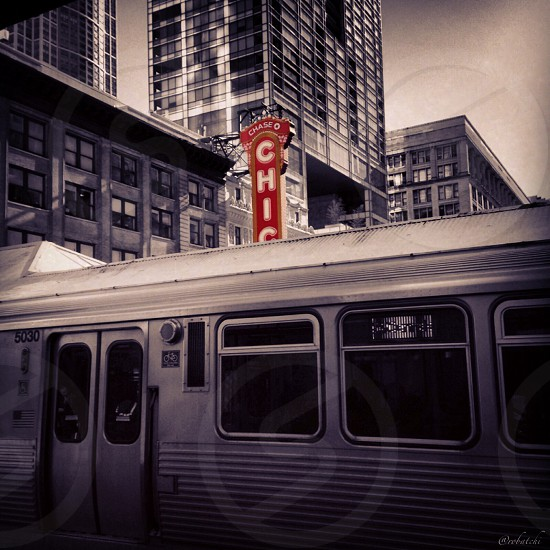 chicago railway along high rise buildings black and white photography photo