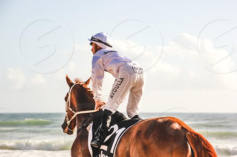 jockey on horseback at the beach in Surfers Paradise Queensland Australia photo