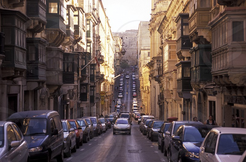 A smal road in the centre of the Old Town of the city of Valletta on the Island of Malta in the Mediterranean Sea in Europe.