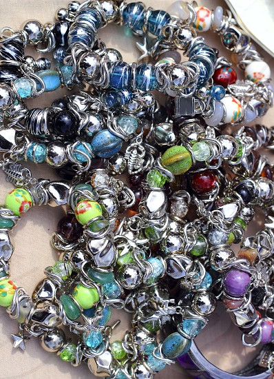 colorful jewelry necklaces mess in market pattern background   photo