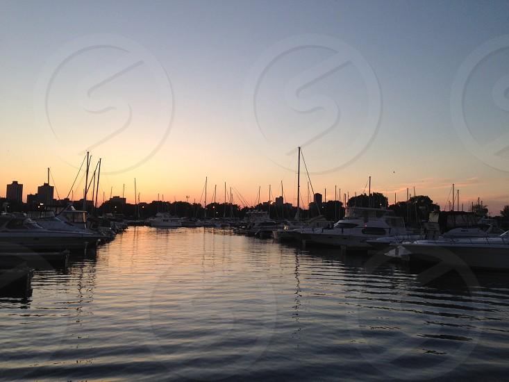 Boats harbor water sunset lake sails photo