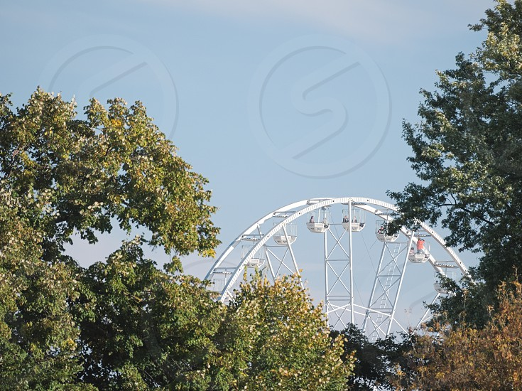 Ferris Wheel between Trees on a Sunny Autumn Day in Győr Hungary photo