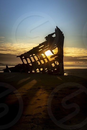 Oregon shipwreck sunset photo