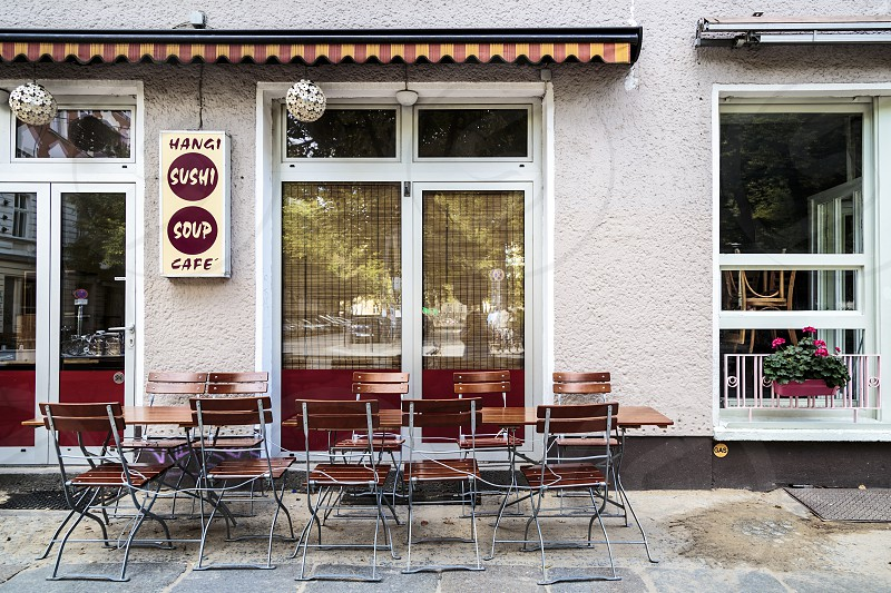 Table and chairs outside asian cafe in Berlin Germany photo