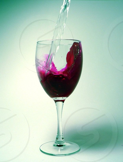 Water to Wine Motion Unique Red Clear Splash Glass Bible photo