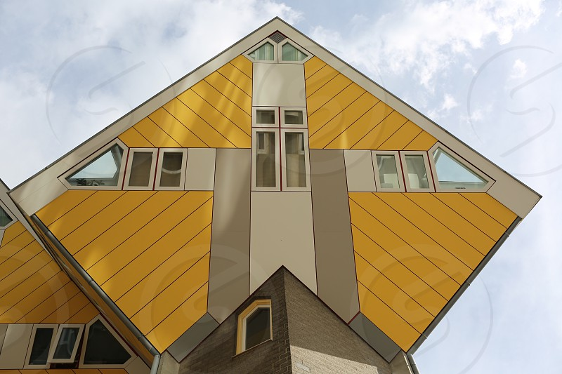 photo of yellow and white diamond shaped building photo