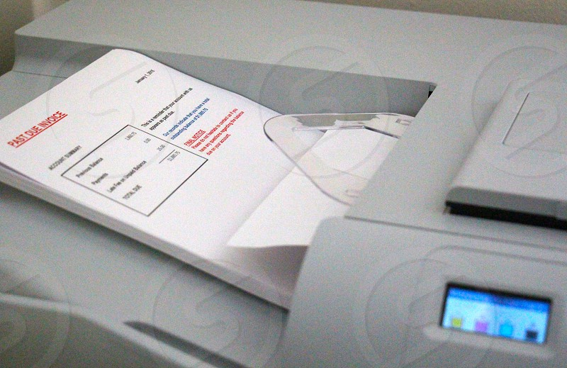 past due invoice account summary on gray printer photo