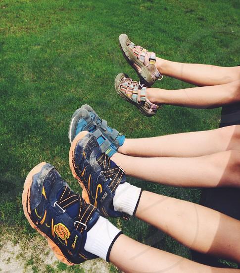 Children's Legs Wearing Athletic Sneakers photo