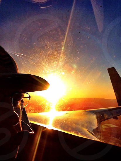 Pilot flying an experimental aircraft in the sunset  photo