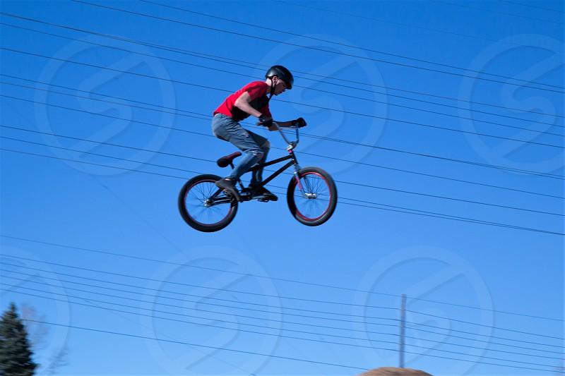 Young tean's daring stunt at bicycle terrain park. photo