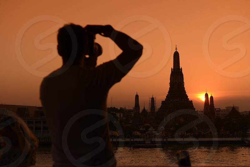 Tourists near the Wat Arun during a rally at theDemocracy Monument in .Bangkok Thailand Saturday Jan.11  2014. photo