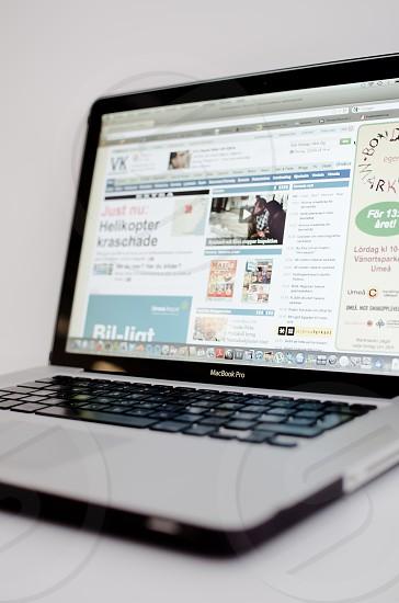 macbook pro laptop open on gray table photo