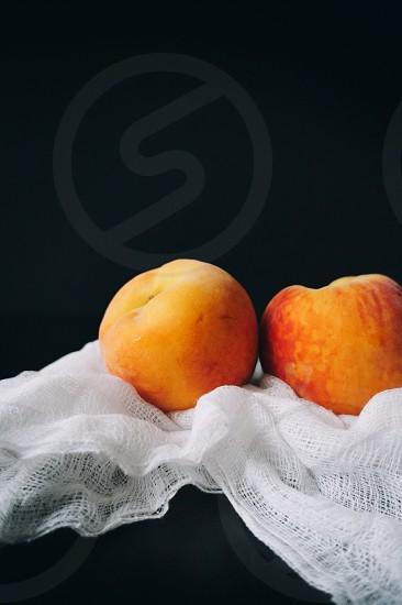 Plump ripe peaches.  photo