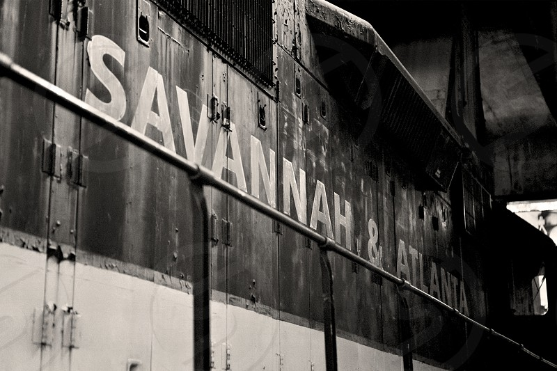 Soft Light illuminating the 'Savannah & Atlanta' lettering on the side of an old Diesel Locomotive at the historic Savannah Roundhouse in Southern Georgia. photo