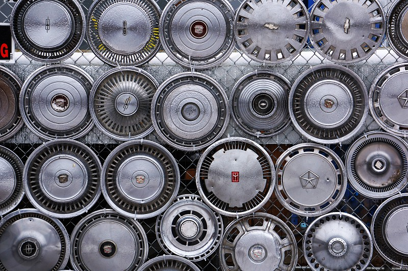 Wall of vintage hubcaps photo