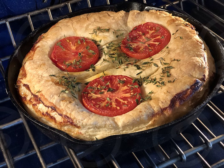 Lifestyle Cooking and Cuisine Leek Pie Tart In a Cast Iron Skillet Cooking Gourmet Cast Iron Skillet Tomatoes Food Food Art Thought Provoking Marketing Cooking With Cast Iron photo
