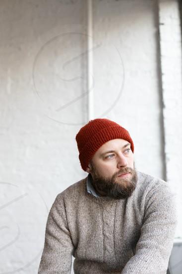 men's red beanie  photo