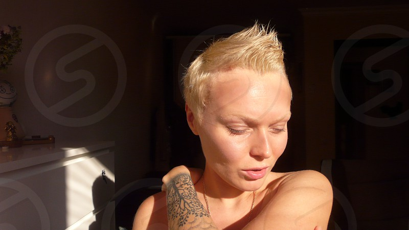 Expressive blonde girl with tattoo  photo