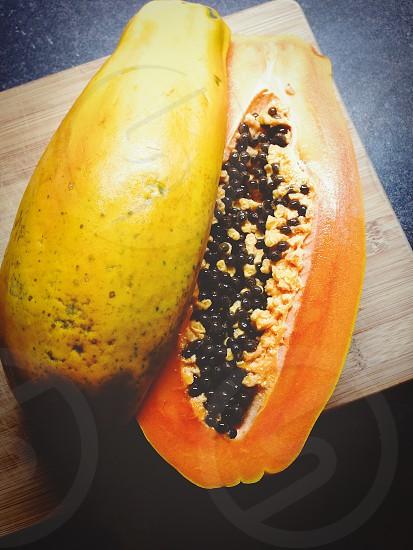 fresh papaya cut in half photo