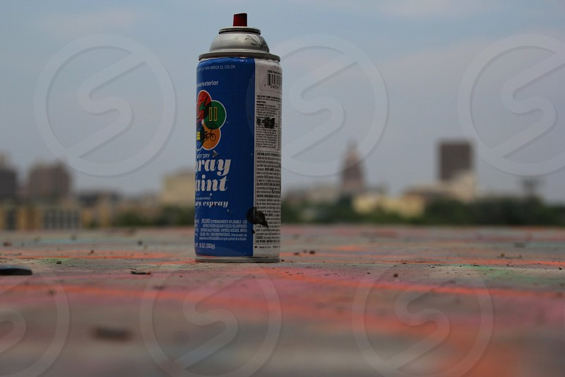 blue and white labeled spray can photo