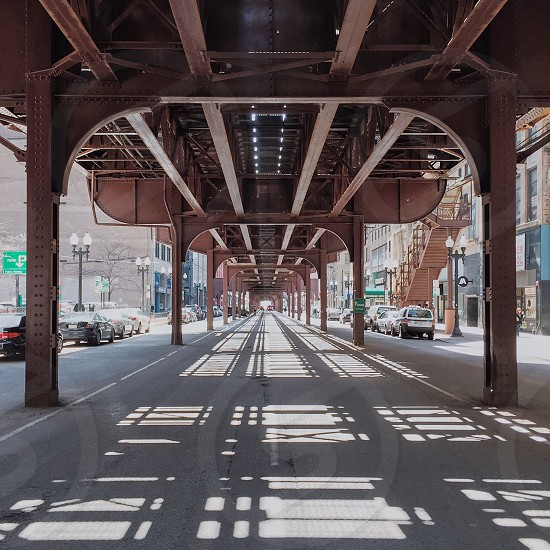 sunlight peak on brown metal bridge photo