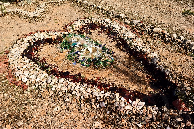 A stone heart created from rock and broken glass in the abandoned ghost town of Sundad Arizona. Started in the 1920s as a Tuberculosis Sanitarium but was abandoned in the 1940s. photo