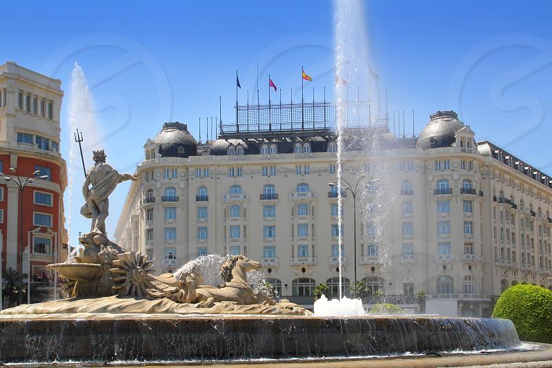 Madrid Neptuno fountain in Paseo de la Castellana Spain photo