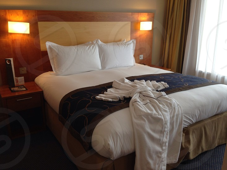 Bedroom bed bathrobe relax hotel photo