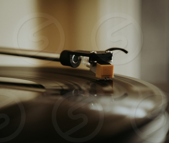 Listening to music on a turntable.  photo