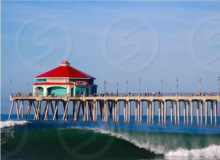 Travel to Orange County to catch some waves in perfect weather. photo