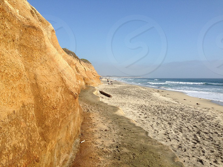 Beach ocean eroding cliffs photo