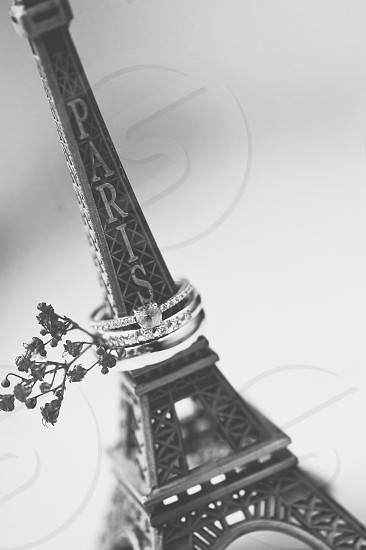 eiffel tower paris with 2 silver diamond ring in grayscale photography photo