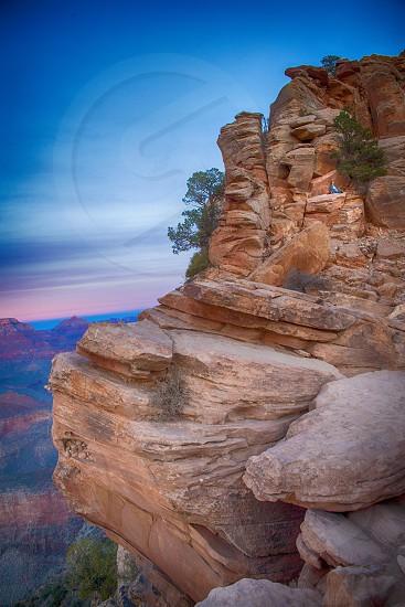 Grand Canyon Arizona hiker hiking rock slope travel awe inspiring mountains  photo