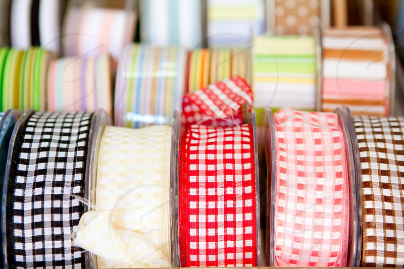 fabric tapes reels in haberdashery of vichy squares photo