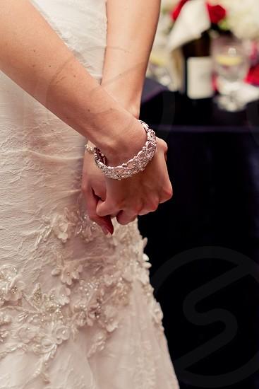 person wearing a silver bracelet photo
