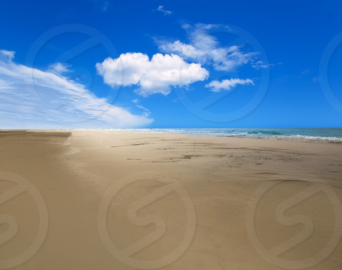 Maspalomas Playa del Ingles beach sand and blue sky in Gran Canaria photo