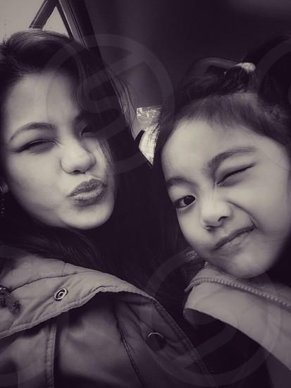 Mom and daughterwinkcutesweettravelingwinter photo